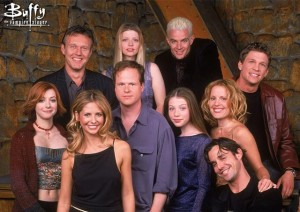 Joss Whedon poses with the Buffy gang.
